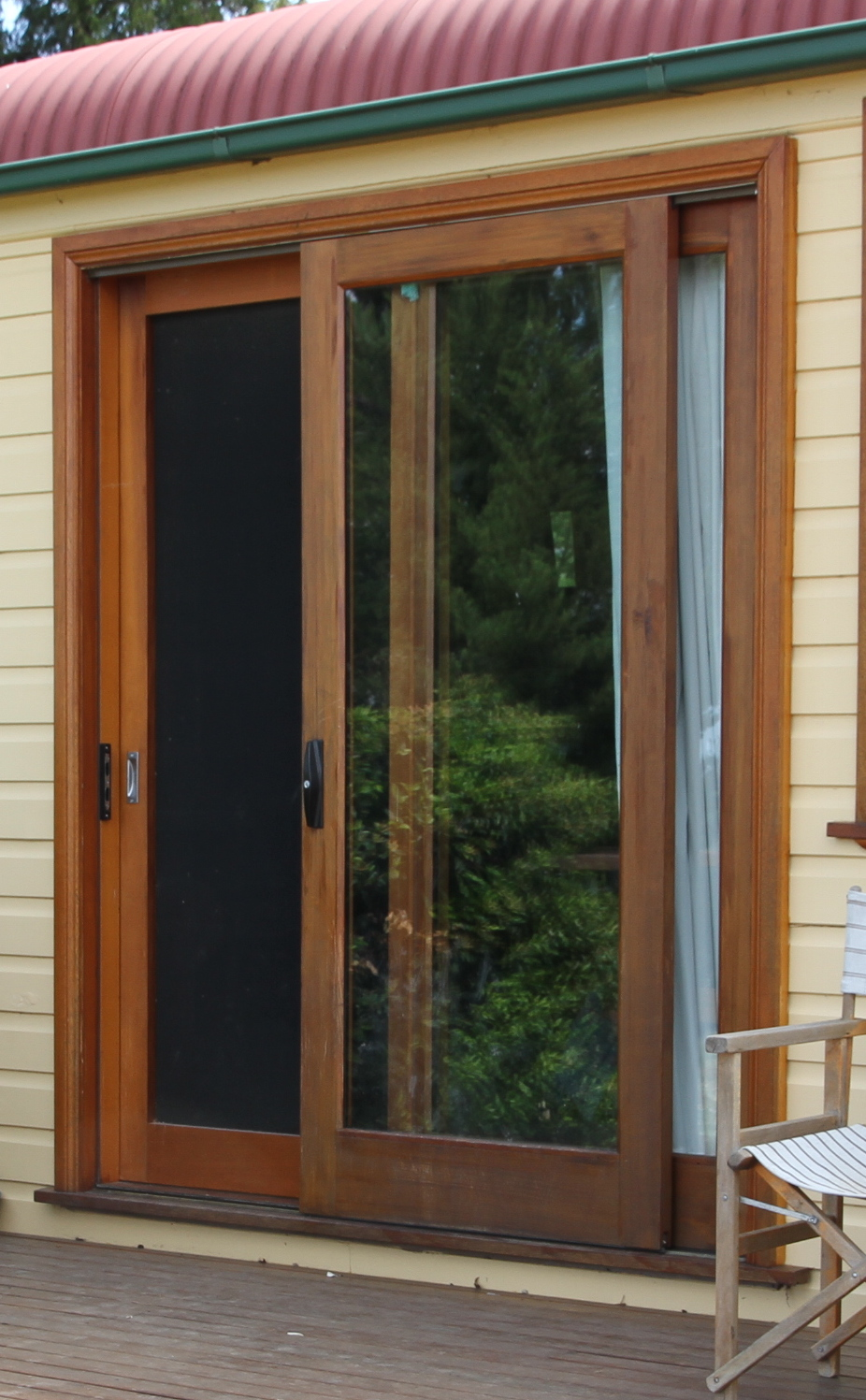 Flywire doors s le of our tailor made fly screen doors for Wooden sliding doors