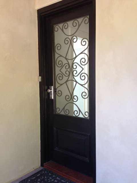 Entrance Door with Trans Laminate and Black Wrought Iron Insert