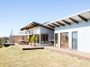 Rammed Earth and Corrugated Iron Home featuring Moar Windows & Doors